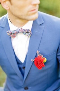 groom-with-patterned-bowtie-and-flower