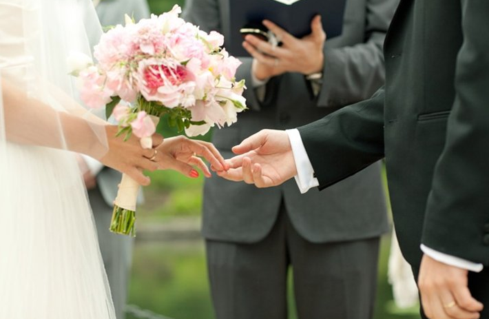 Wedding Vows - Couple At Altar