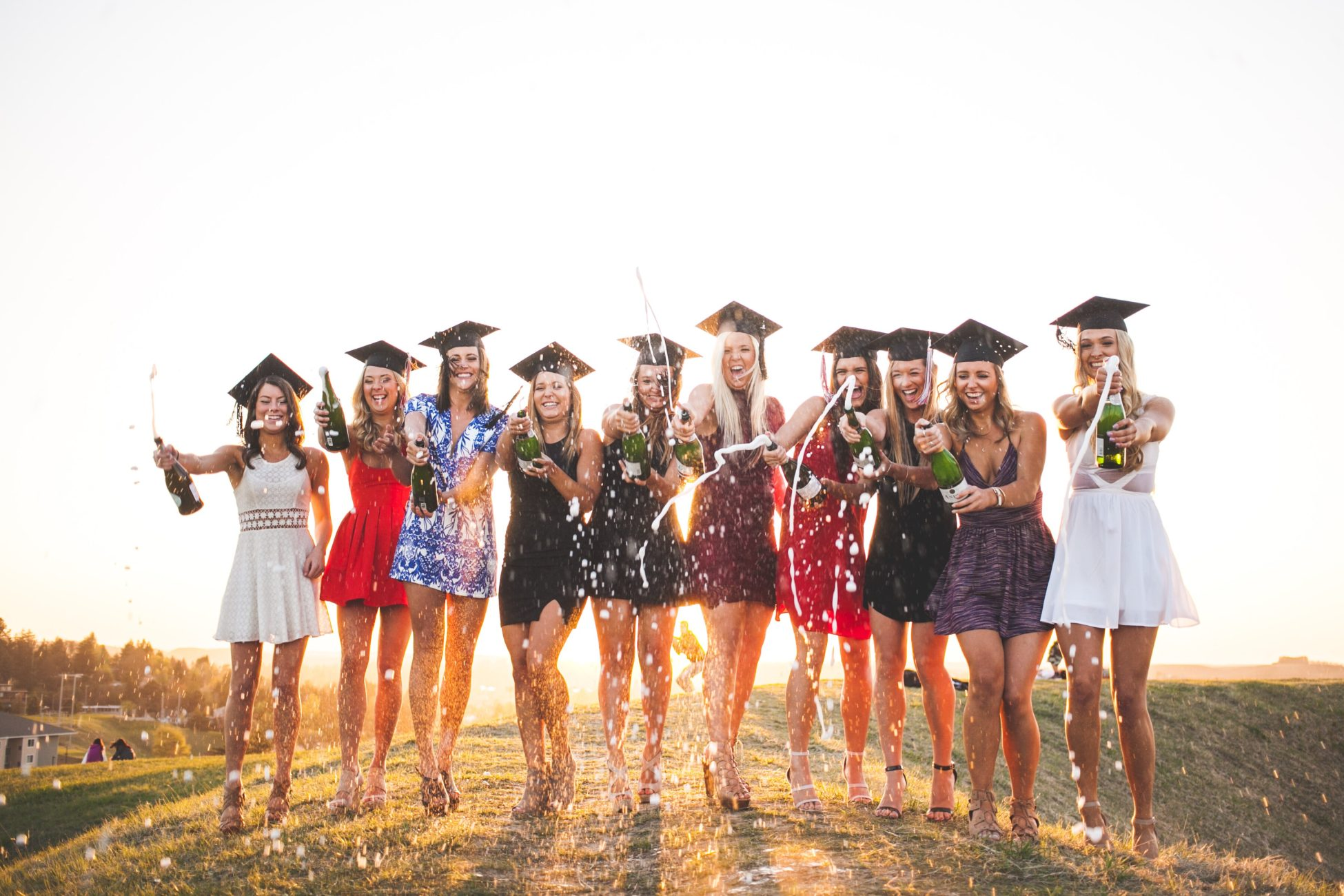 group of girls celebrating graduation - graduation party ideas