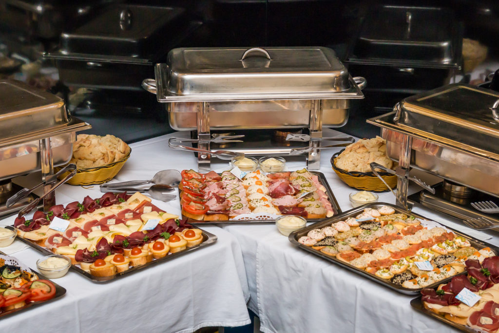 catered food on table - graduation party ideas