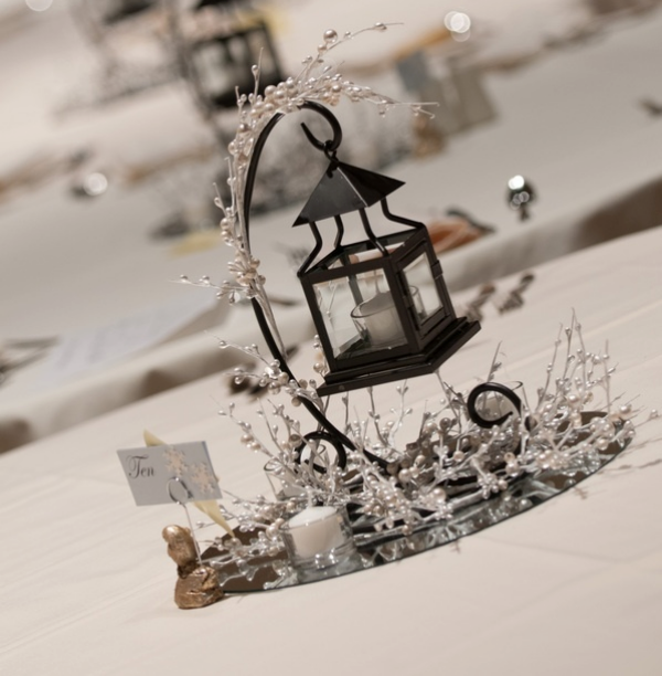 candle and lantern winter wedding centerpieces