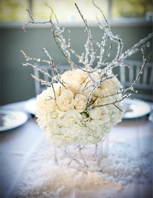 frozen tree with flowers and snow winter wedding centerpieces