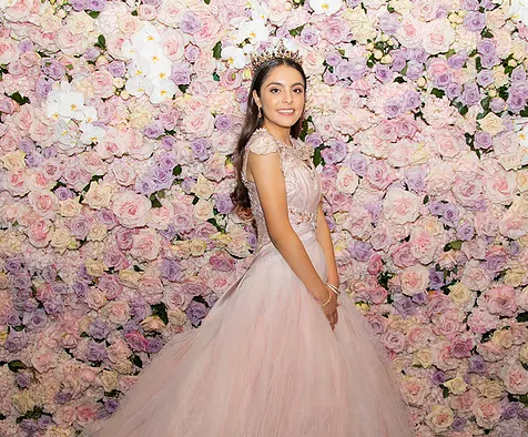 Quinceanera Photography - Birthday Girl Against Flower Wall