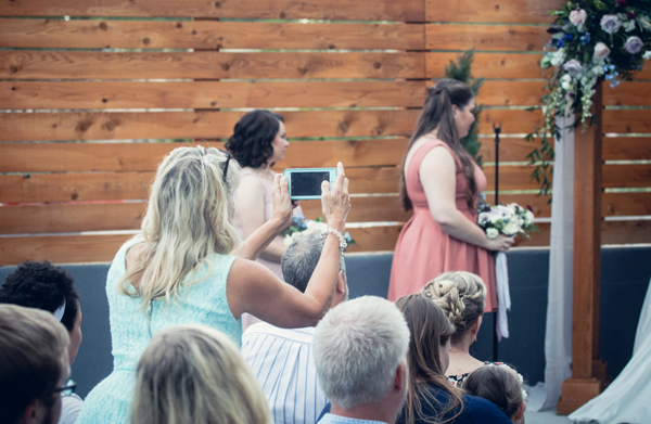 Unplugged Wedding - Wedding Guest Standing Up To Take Picture