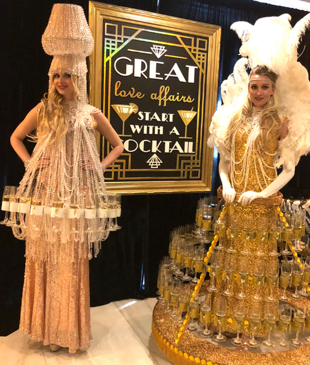 Great Gatsby Party Theme - Two Women Wearing Strolling Champagne Dresses