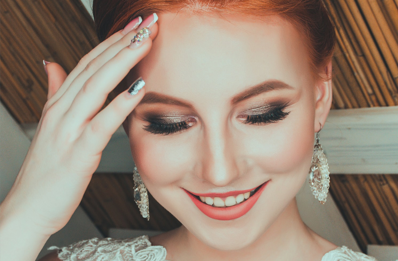 Redheaded Woman With Bridal Makeup