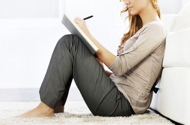 Wedding Planning Problems - Woman Writing In Journal Sitting On Floor